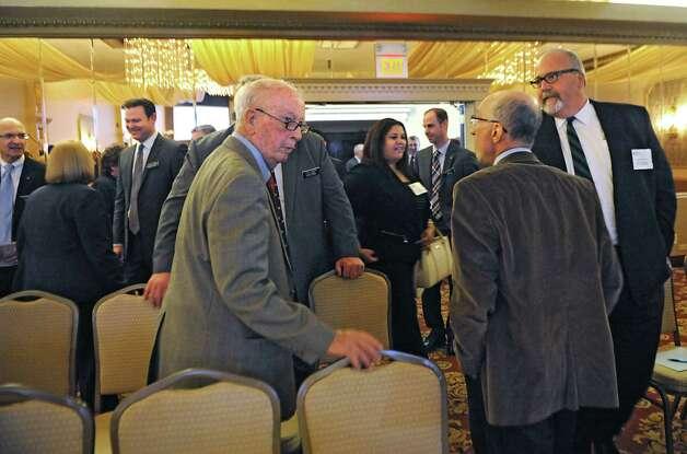 People mingle before the TrustCo Bank Corp NY annual shareholder's meeting at Mallozzi's Restaurant on Thursday, May 21, 2015 in Rotterdam, N.Y. (Lori Van Buren / Times Union) Photo: Lori Van Buren / 00031939A