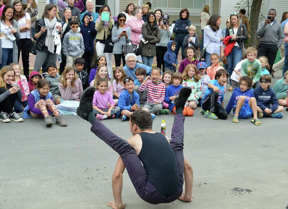 Jared Rydelek, a contortionist from New York City, mesmerized the crowd at the Art About Town street party. Photo: Jarret Liotta / Westport News