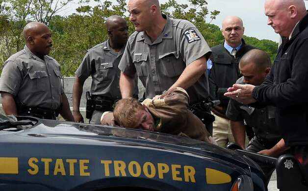 State Police take a male in to custody on the I-90 bridge's west bound lane Thursday morning May 21, 2015 after a high speed chase that ended in Albany, N.Y.    (Skip Dickstein/Times Union) Photo: SKIP DICKSTEIN