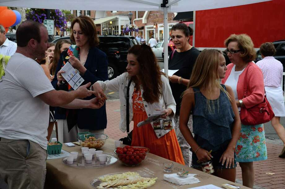 "One of the big events held last summer in New Canaan's seasonal Pop-Up Park was the fourth annual Taste of the Town Stroll in New Canaan. This year, the Pop-Up Park is back and public safety officials are examining a request to keep the park ""popped up"" for the whole summer instead of just on weekends. Photo: File Photo, Nelson Oliveira / New Canaan News"
