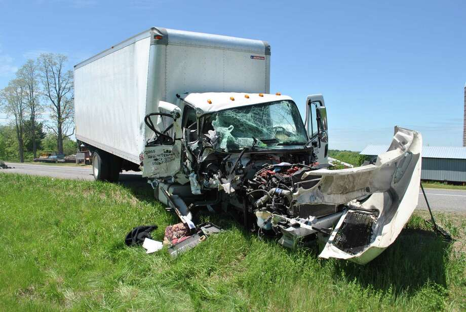 This 2013 Freightliner was badly damaged and the driver seriously injured when it collided with another truck in Greenwich on Thursday, State Police said. (State Police)