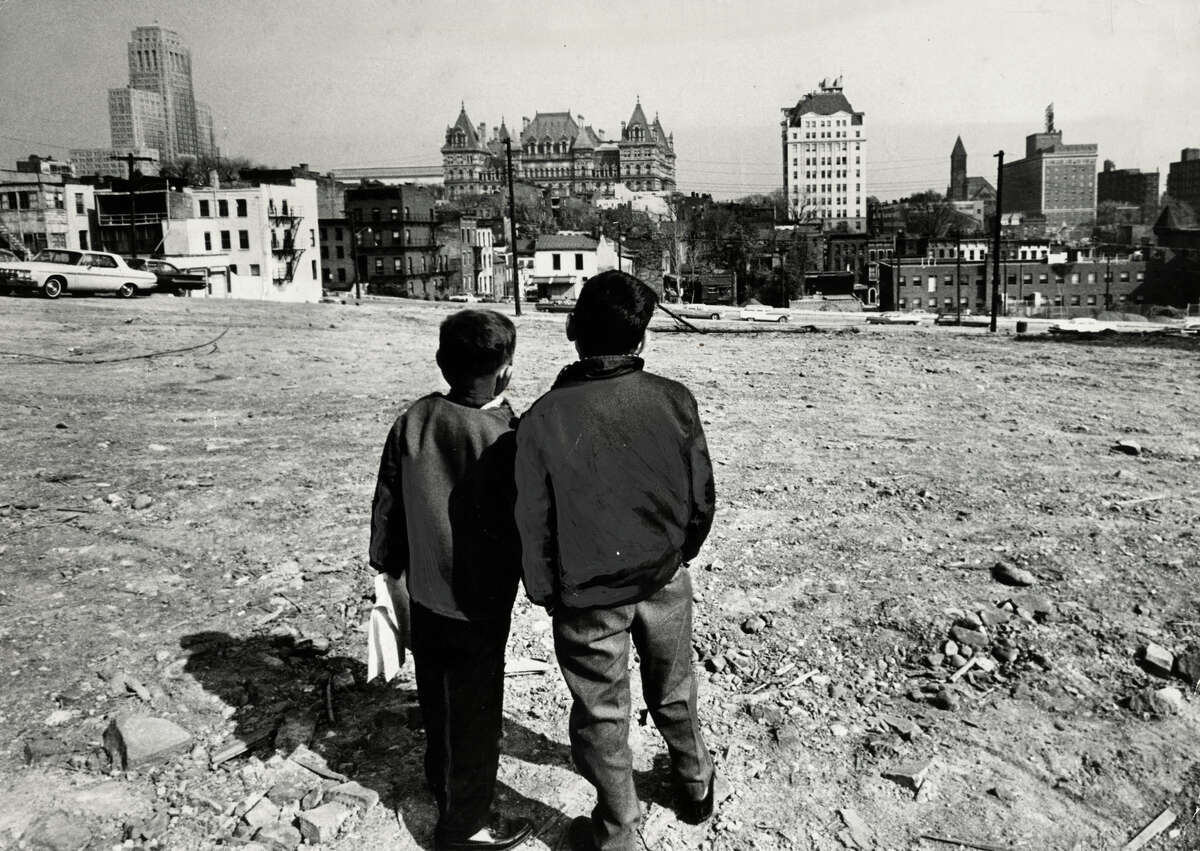 Two boys view a demolished block for construction of the South mall near the Cathedral of the Immaculate Conception Oct. 22, 1963, in Albany, N.Y. Historic Empire State Plaza, South Mall.