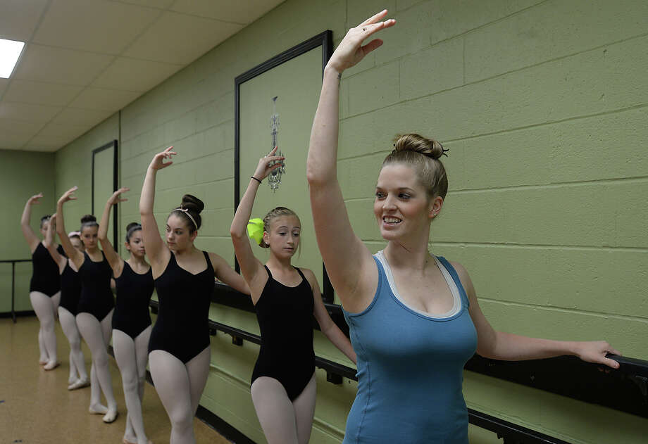"Amanda Portie Bass instructs students in her ballet class in Groves Thursday. Bass was cast as an extra in ""Pitch Perfect 2,"" which was released last week. Photo taken Thursday, May 21, 2015 Kim Brent/The Enterprise Photo: Kim Brent / Beaumont Enterprise"