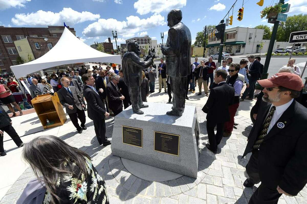 Officials in Schenectady unveiled a statue Friday morning that depicts General Electric founder Thomas Edison and GE scientist Charles Steinmetz. Edison and Steinmetz teamed up to lead General Electric?s spectacular growth in Schenectady a century ago. (Skip Dickstein / Times Union)