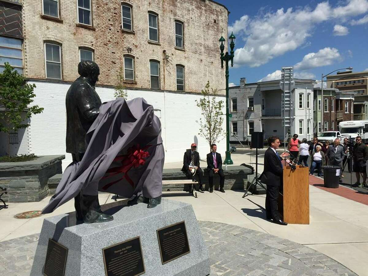 A stiff wind unveiled a statue Friday morning that depicts General Electric founder Thomas Edison and GE scientist Charles Steinmetz. The statue was installed at the intersection of Erie Boulevard and South Ferry Street in Schenectady. The location is just a few blocks from GE's downtown plant. Edison and Steinmetz teamed up to lead General Electric?s spectacular growth in Schenectady a century ago. (Skip Dickstein / Times Union)
