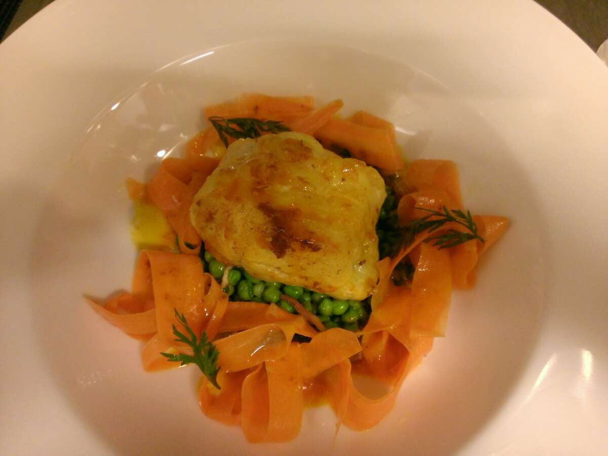 Carrot coated monkfish, French style green peas, shaved new carrots