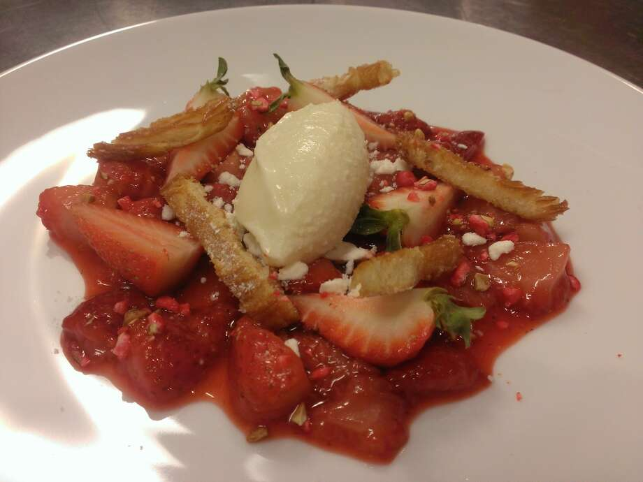 Fresh and roasted strawberries, crispy meringue, palmier cookie, yogurt and honey ice-cream Photo: Courtesy Saveurs 209