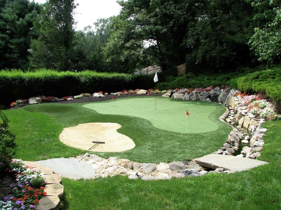 Avid golfers with space and budget can practice putting and chipping with backyard putting greens and sand traps. Photo: Courtesy Southwest Greens