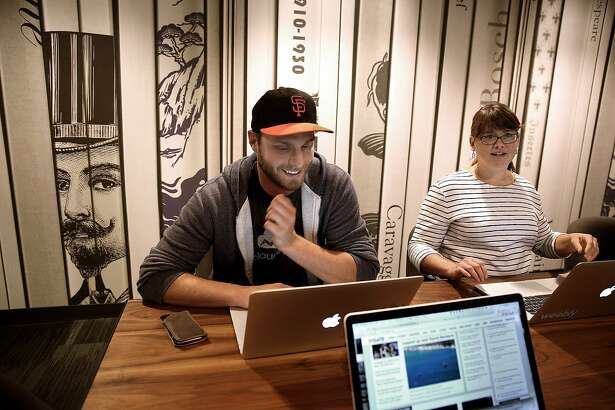 Senior product manager James Detmer (left) and manager of engineering Katie Willard (right) have a meeting at Weebly in San Francisco, California, on Thursday, May 21, 2015.