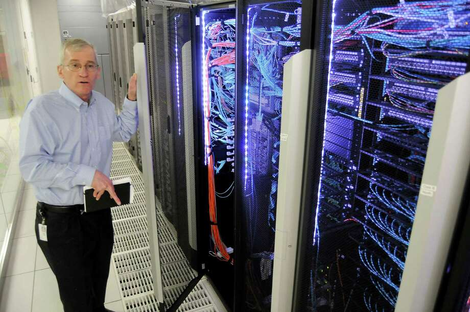 BP's Keith Gray, director of technical computing and the Center for High Performance Computing, talks about the company's computing power during a tour of the facilities Wednesday May 20, 2015.(Dave Rossman photo) Photo: Dave Rossman, Freelance / Freelalnce