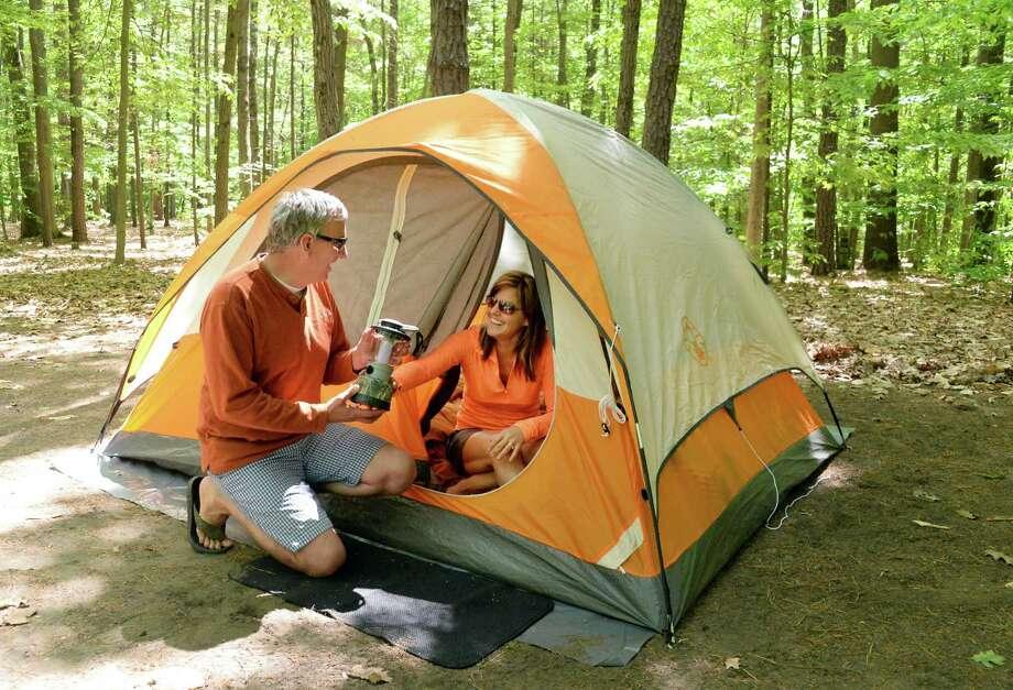 Dan and Sharon Way of Balston Lake set up camp at Moreau Lake State Park for the holiday weekend Friday May 22, 2015 in Gansevoort, NY.  (John Carl D'Annibale / Times Union) Photo: John Carl D'Annibale / 00031933A