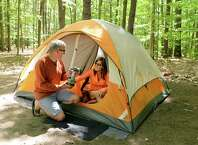 Dan and Sharon Way of Balston Lake set up camp at Moreau Lake State Park for the holiday weekend Friday May 22, 2015 in Gansevoort, NY.  (John Carl D'Annibale / Times Union)
