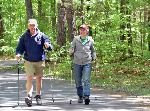 Campers Frank and Cathy Brush of Charlton hike through Moreau Lake State Park Friday May 22, 2015 in Gansevoort, NY.  (John Carl D'Annibale / Times Union) Photo: John Carl D'Annibale / 00031933A