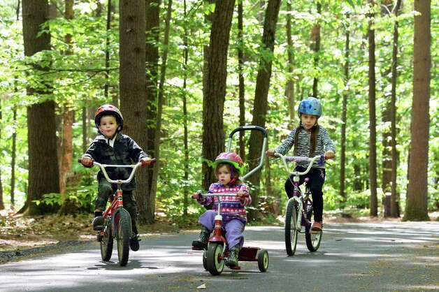 Young campers, from left, Logan Mickles, 4, of Stillwater, Kalea Watkins, 2, of Cohoes and Liliana Mickles of Stillwater, bicycle at Moreau Lake State Park for the holiday weekend Friday May 22, 2015 in Gansevoort, NY.  (John Carl D'Annibale / Times Union) Photo: John Carl D'Annibale / 00031933A