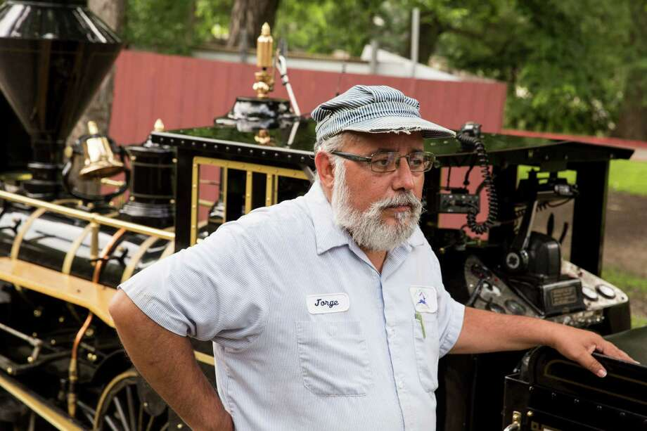 Jorge Pina waits for guests to board the train at the San Antonio Zoo on Tuesday, May 19, 2015 in San Antonio, Texas. Photo: Carolyn Van Houten, Staff / San Antonio Express-News / 2015 San Antonio Express-News