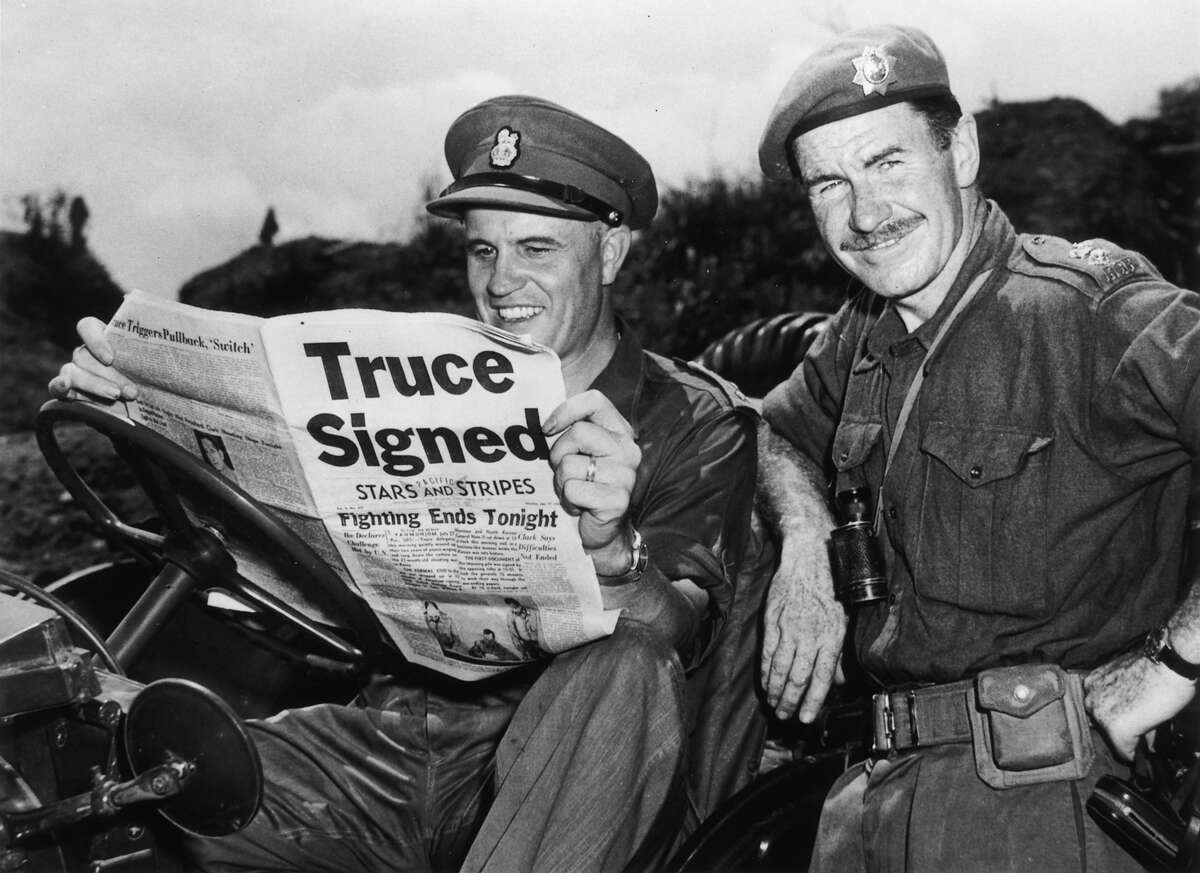 Brigadier Jean Allard, Commanding Officer of the Canadian Brigade breaks the news of a truce in the Korean war to Colonel K L Campbell, Commander of the 3rd battalion of the RCRS.