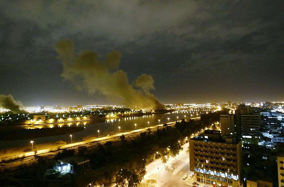 """In this March 20, 2003 file photo, smoke rises from the Trade Ministry in Baghdad after it was hit by a missile during US-led forces attacks. In the beginning, it all looked simple: topple Saddam Hussein, destroy his purported weapons of mass destruction and lay the foundation for a pro-Western government in the heart of the Arab world. Nearly 4,500 American and more than 100,000 Iraqi lives later, the objective became is simply to get out, and leave behind a country where democracy has at least a chance, where Iran does not dominate and where conditions may not be good but """"good enough.""""  Photo: Jerome Delay, AP"""