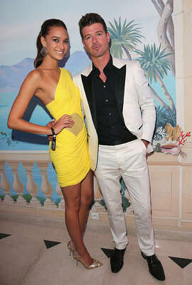 April Love Geary and Robin Thicke attend the De Grisogono party during the 68th annual Cannes Film Festival on May 19, 2015 in Cap d'Antibes, France.