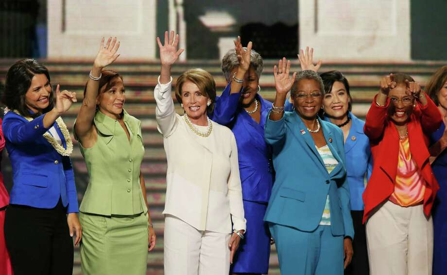Women, including House Minority Leader Sen. Nancy Pelosi, third from left, have made inroads in Congress. But, a National Journal report says women staffers suffer under a work culture in which their male bosses won't mentor and guide them because of false fears. Photo: Alex Wong /Getty Images / 2012 Getty Images