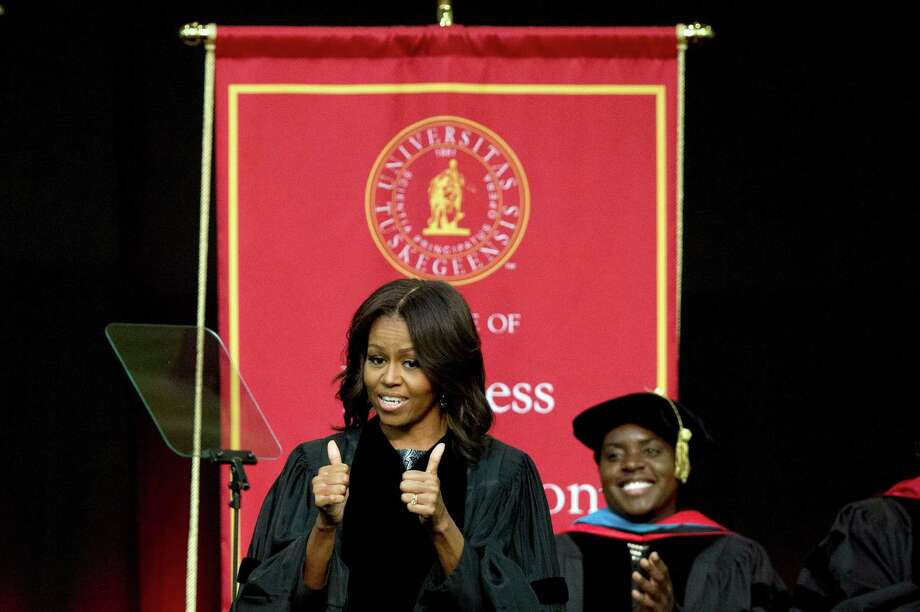 First lady Michelle Obama gives a thumbs up before delivering the commencement address at Tuskegee University in early May. A reader defends the first lady from a recent column that criticized her for describing what she perceived as racially motivated behavior toward her. Photo: Brynn Anderson /Associated Press / AP