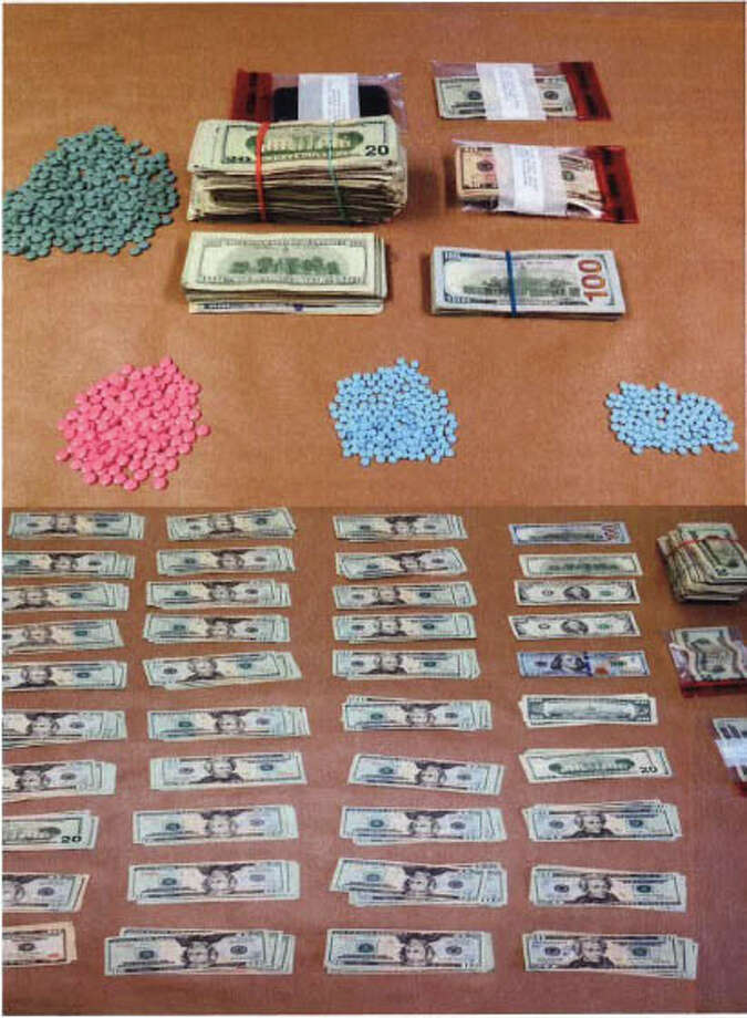Police seized narcotic pain pills and cash from an Easton couple's home, following a lengthy investigation. The couple was arrested on drug charges. Photo: Contributed Photo /  Fairfield Citizen contributed
