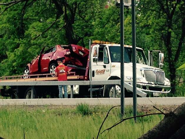 A crumpled car is removed from the crash scene near Exit 3 on Interstate 90 in Albany. The crash on the westbound side caused heavy traffic delays in the vicinity of the crash. (Lori Van Buren / Times Union)