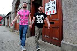 A gay couple hold hands after walking out of a polling station in Drogheda, north Dublin. They voted on whether same-sex marriage should be legal.