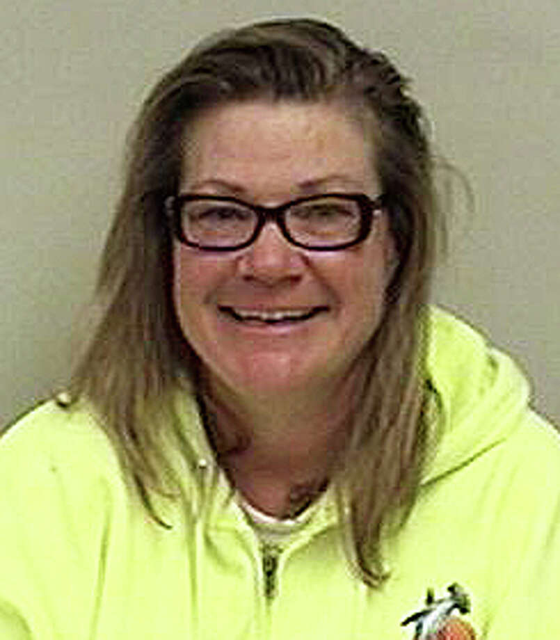 Amy Gustafson, 47, of Grove Point Road faces a series of charges -- ranging from assault and driving under the influence to burglary and carrying a dangerous weapon -- in connection to incidents on two consecutive days at neighboring properties. Photo: Westport Police Department / Westport News