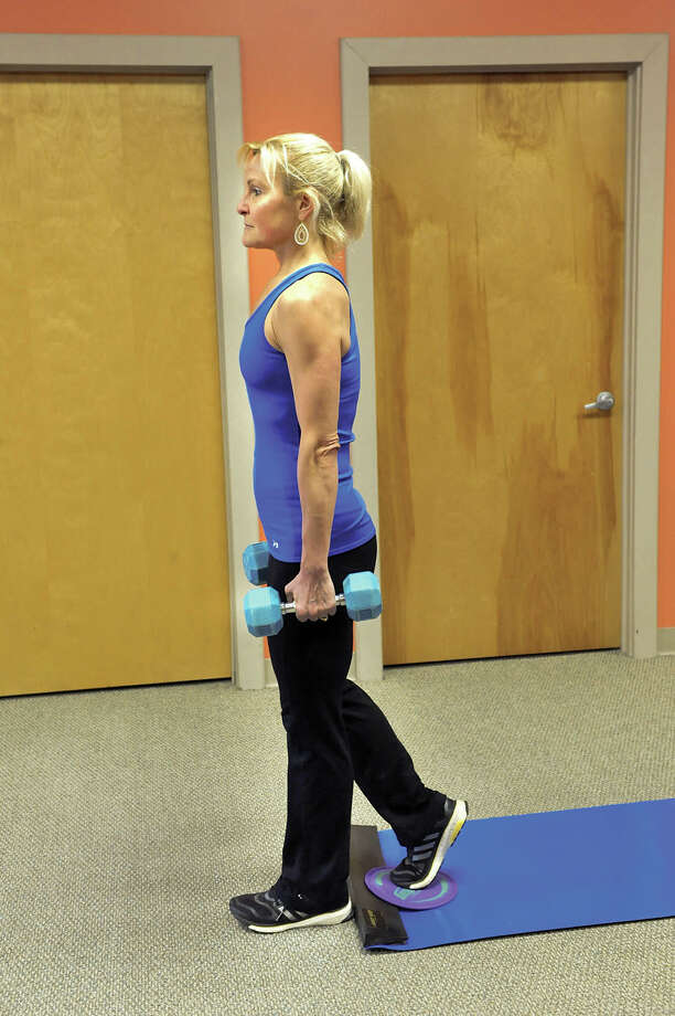 Trainer Judy Torel demonstrates the starting position using a sliding disc for deep gluteal muscle strengthener on Tuesday, April 7, 2015, at her training studio in Albany, N.Y. Photo: Cindy Schultz / Times Union / 00031146A