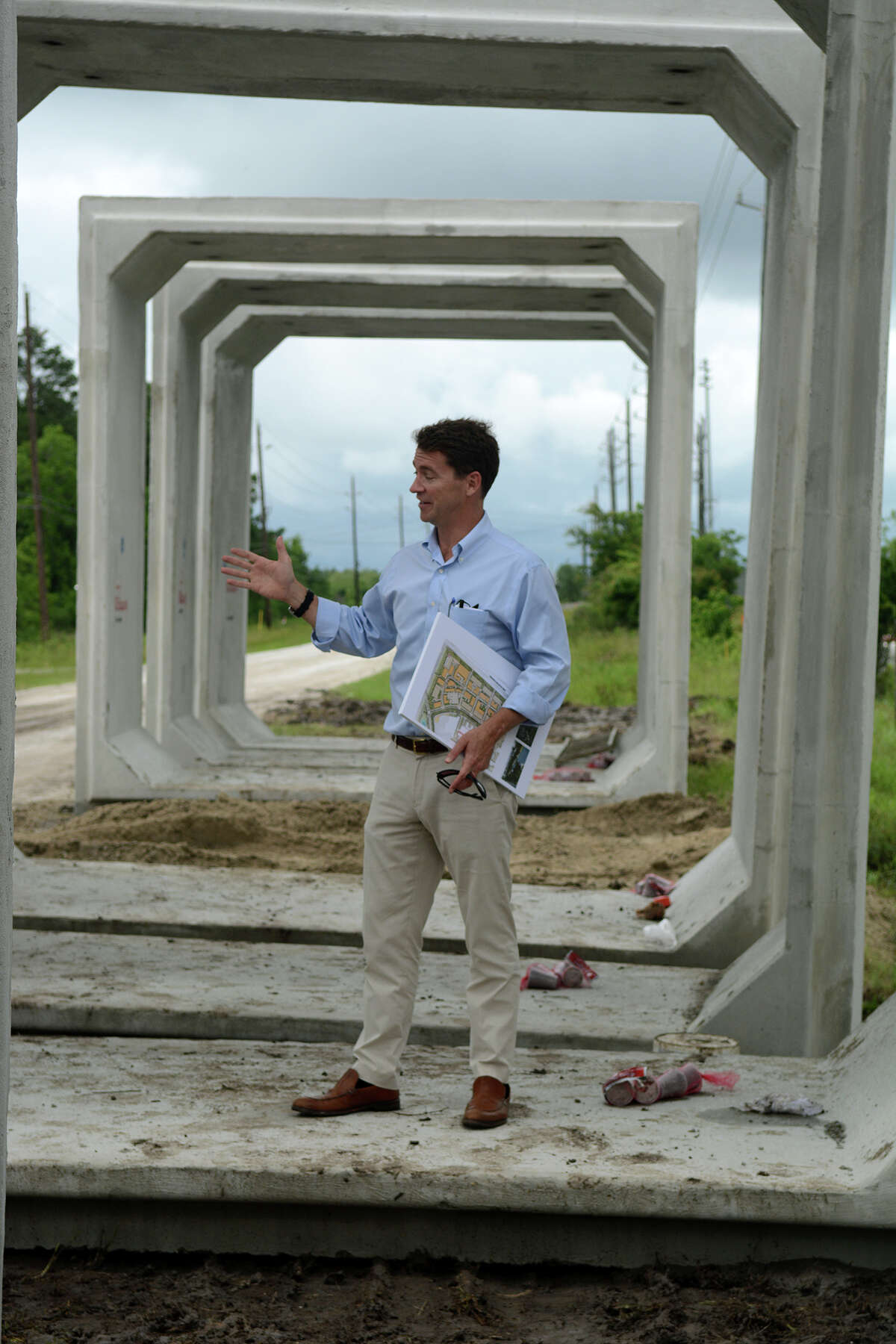 Ryan McCord, President of McCord Development, Inc., standing inside a box culvert to be buried and used for drainage, talks about the development of Generation Park during a tour of the 4,000-acre mixed-use project in northeast Houston on Thursday, May 21, 2015. (Photo by Jerry Baker/Freelance)