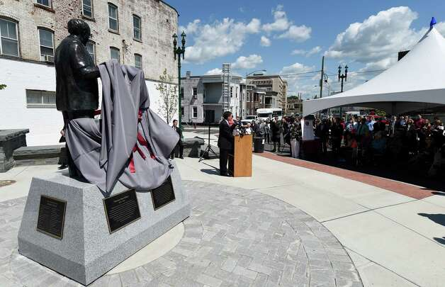 High winds prematurely unveiled the bronzes of Thomas Edison and Charles Steinmetz at their official unveiling at the corner of Erie Blvd. and Ferry Street Friday, May 22, 2015, in Schenectady, N.Y. (Skip Dickstein/Times Union) Photo: SKIP DICKSTEIN / 00031861A