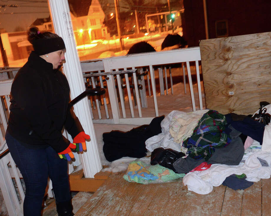 """Eneida Martinez, describes how three homeless people live at an abandoned church on Fairfield Avenue in  Bridgeport, Conn. on Tuesday Feb. 17, 2015. Martinez and about forty other workers and volunteers scoured the region as part of the 2015 """"Point-In-Time"""" Homeless Count. Photo: Christian Abraham / Connecticut Post"""