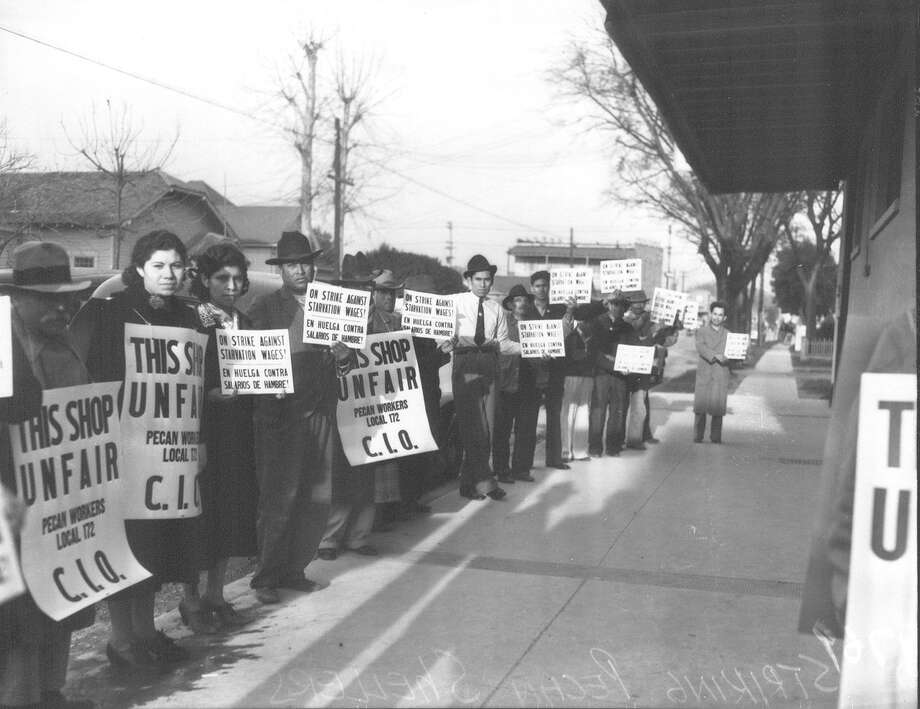 Striking pecan shellers picketing on the sidewalk in front of Southern Pecan Shelling Company at 135 E. Cevallos Street. Photo published in the Light on Feb. 25, 1938. Photo: Courtesy Photo /UTSA Special Collections / San Antonio Light Collection