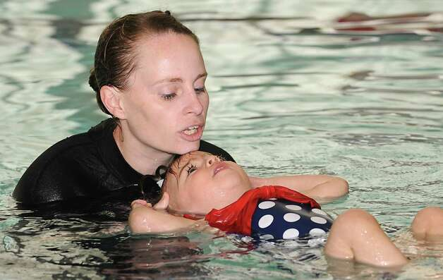 "Anthea Morris teaches Victoria O'Brien, 1 1/2 yrs-old, of Colonie how to swim at Mohonasen High School Wednesday, May 13, 2015 in Schenectady, N.Y. This swim instruction program teaches children as young as 6 months to keep their head above water and, in some cases, ""swim"" to the edge of the pool. (Lori Van Buren / Times Union) Photo: Lori Van Buren / 00031815A"