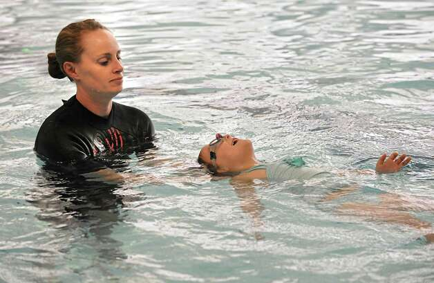 "Anthea Morris teaches Eva Dunham, 3 of Glenville how to swim at  Mohonasen High School Wednesday, May 13, 2015 in Schenectady, N.Y. This swim instruction program teaches children as young as 6 months to keep their head above water and, in some cases, ""swim"" to the edge of the pool. Eva was almost a drowning victim when she was younger. (Lori Van Buren / Times Union) Photo: Lori Van Buren / 00031815A"