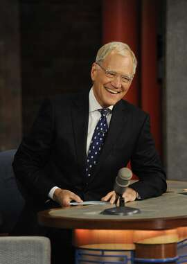 """David Letterman ends his final broadcast of the """"Late Show With David Letterman"""" on Wednesday, May 20, 2015, at the Ed Sullivan Theater in New York. (Jeffrey R. Staab/CBS/TNS)"""