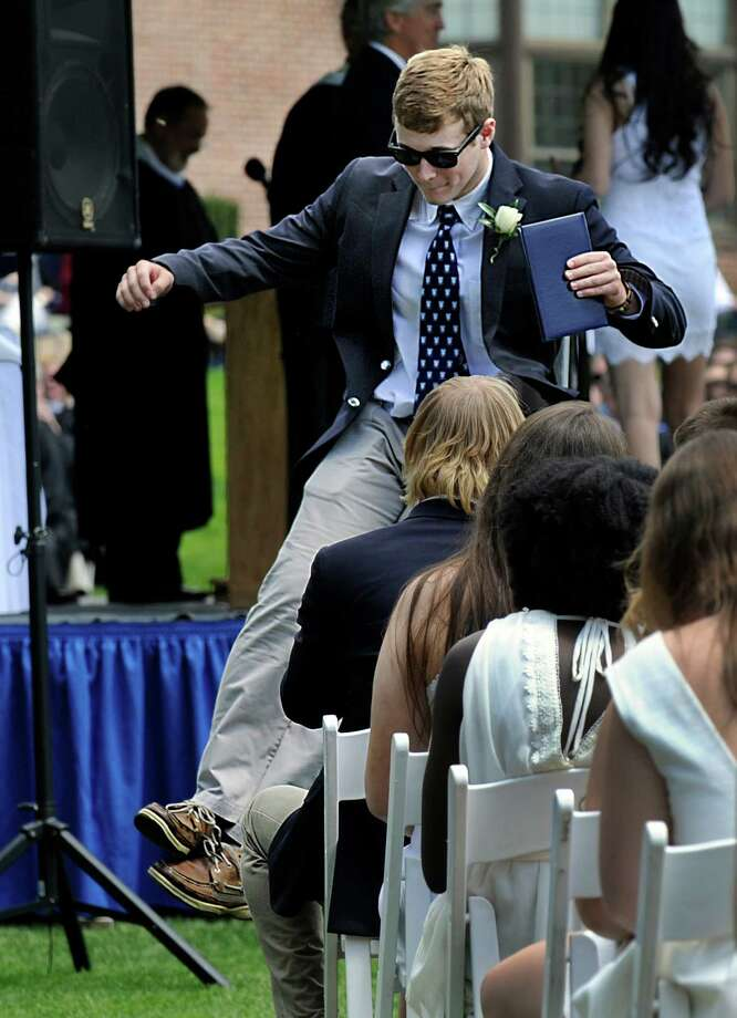 Bryce Giopal kicks his heels in the air after receiving his diploma from Canterbury School in New Milford, Conn., Friday, May 22, 2015, at graduation exercises. Photo: Carol Kaliff / The News-Times