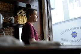 Kurt Abney, owner and chef of Dottie's looks out the window onto 6th St..  Thursday January 26th, 2012.