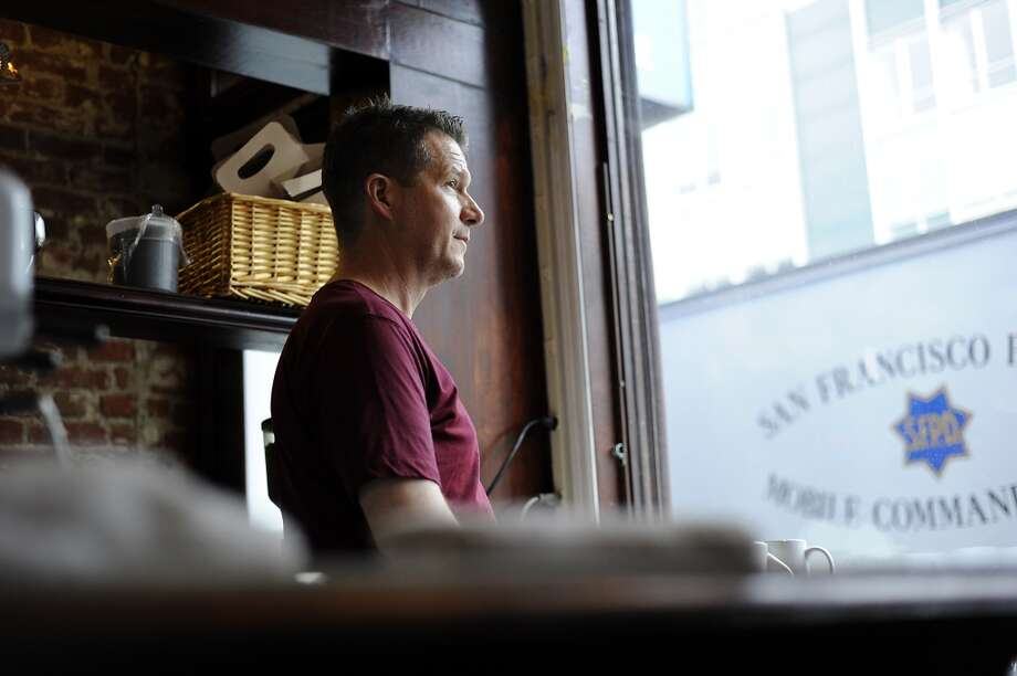 Kurt Abney, owner and chef of Dottie's looks out the window onto 6th St..  Thursday January 26th, 2012. Photo: Michael Short, SPECIAL TO THE CHRONICLE