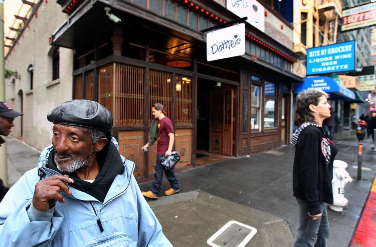 Franklin Hickman panhandles in front of Dottie's True Blue Cafe Friday, Jan. 20, 2012.