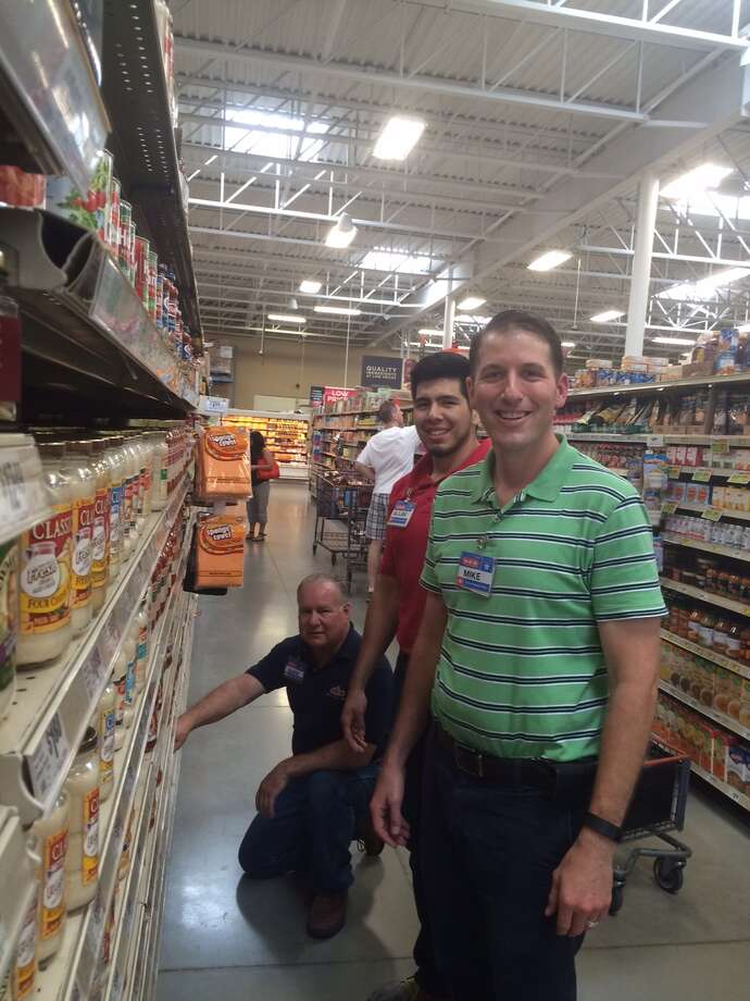 Mike Wills (right), who served in the United States Air Force for eight years, is currently training in the H-E-B School of Retail Leadership. He is training alongside (left) Mark Zamora, grocery manager, and Alan Lara, grocery stocker.