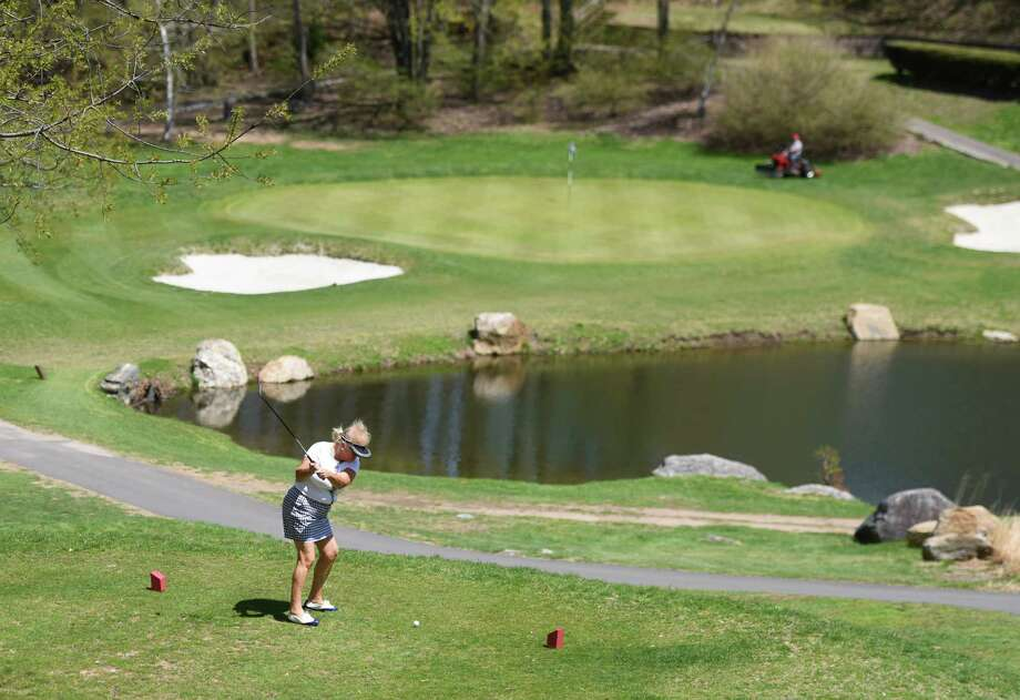 Stamford resident Deb Dill tees off on a par three at the E. Gaynor Brennan Golf Course in Stamford, Conn. Photo: Tyler Sizemore / Greenwich Time