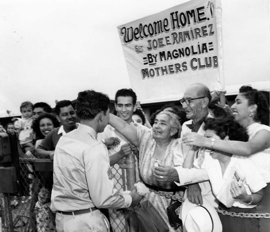 Returned prisoner of war Sgt. Joe Ramirez rushes to the outstretched arms of his mother, Isabel Ramirez, and other family members on his return to Houston. Waiting with his mother at Municipal Airport are his father, Elias Ramirez, and his sisters, Olivia R. Gonzales and Connie Ramon, at far right. Sgt, Ramirez was captured in November 1950 in action near the Yalu River.--08/24/1953 - Photo: Lou Witt, © Houston Chronicle