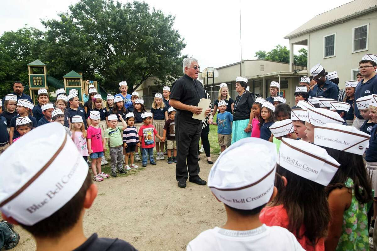 Monsignor Dennis Darilek, St. James Catholic Church parish priest, prayed with about 160 St. James Catholic School students as they gathered on school grounds Friday May 22, 2015 at St. James Catholic School in Seguin, Texas. Along with teachers, parents they prayed for those who became sick from eating the ice cream, employees whose jobs were affected, and the return of Blue Bell ice cream to their lunchroom, school events, and their school store.