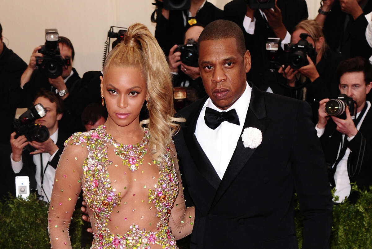 """Beyonce, left, and Jay-Z arrive at The Metropolitan Museum of Art's Costume Institute benefit gala celebrating """"China: Through the Looking Glass"""" on Monday, May 4, 2015, in New York. (Photo by Charles Sykes/Invision/AP)"""