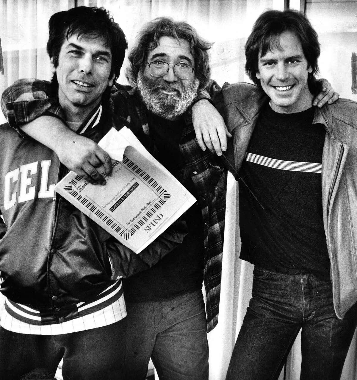 Grateful Dead members Mickey Hart Jerry Garcia and Bob Weir (l to r) inside recording studio Photo taken 12/12/1985 Photo ran 12/22/1985, P. 20