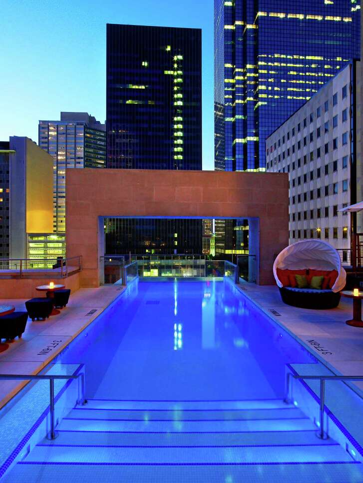 The Joule's rooftop pool extends past the building's edge, giving guests the sensation of swimming out into the air.