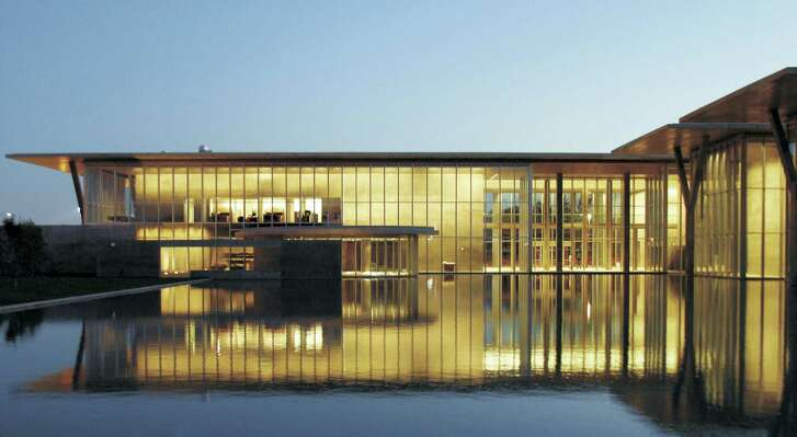 The Modern Art Museum of Fort Worth's building, designed by the Japanese architect Tadao Ando, is accented by a 1.5-acre pond.