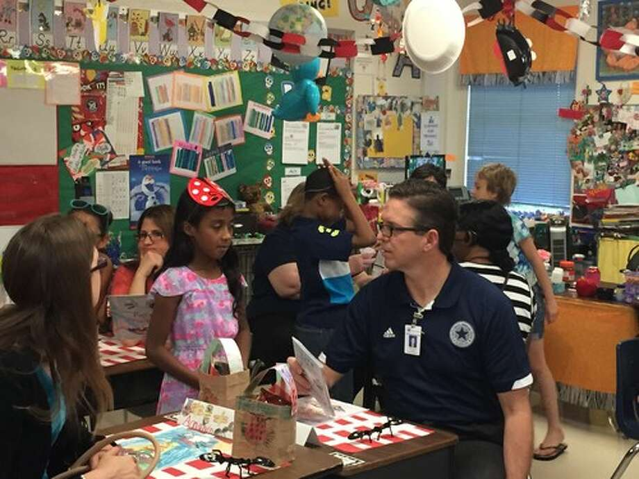 "Students at Rose Garden Elementary School hosted special guests, family and friends during their May 22 ""Reading Restaurant."" Guests were greeted and seated by students, who then gave the customers a list of books. Each person chose a book, which was then read to them by one of the restaurant's many participants. Seated for his reading, at right, is SCUCISD Superintendent Greg Gibson. Photo: Courtesy Photo / Courtesy Photo"