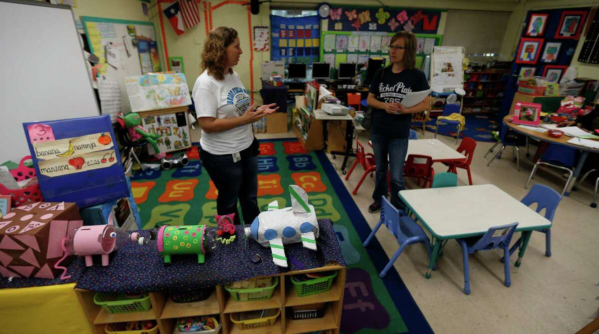 Principal Angela Sugarek, left, gives a tour to Jessica Bacorn, who is looking at potentially sending her kids to Durham Elementary on Friday, May 1, 2015, in Houston. Durham Elementary, 4803 Brinkman, is a school that has tremendous neighborhood support despite its F ranking from children at risk. ( Karen Warren / Houston Chronicle )